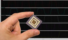 Microprocessor in hand over  signals plots Stock Photos