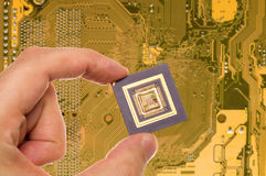 Microprocessor in hand and PCB Stock Images