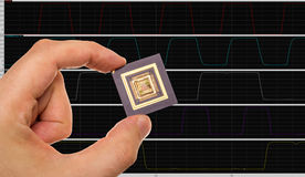 Microprocessor in hand and signals Royalty Free Stock Images