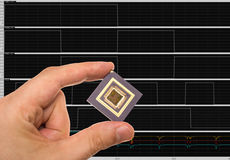 Microprocessor in hand and signals Stock Images