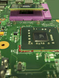 The microprocessor and its socket on the motherboard royalty free stock photo