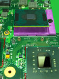 The microprocessor and its socket on the motherboard royalty free stock photography