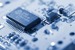 Microprocessor with motherboard background. Computer board chip circuit. Microelectronics hardware concept. Electronic device stock image