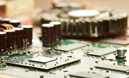 Microprocessor with motherboard background. Computer board chip circuit. Microelectronics hardware concept. Electronic device stock photography