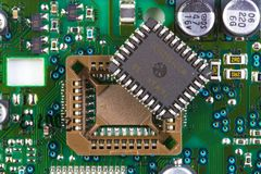 Microprocessor socket with chip. Microprocessor socket on green printed circuit board Royalty Free Stock Images
