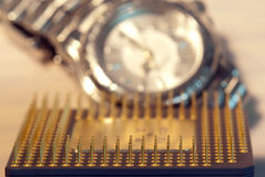 Microprocessor and  a watch Royalty Free Stock Photos