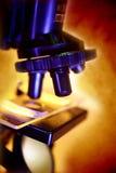 Microscope. Scientific microscope on bright background Stock Image