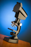 Microscope against blue gradient Stock Photography