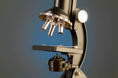 Microscope against  gradient background Stock Photos