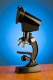 Microscope against  gradient background Royalty Free Stock Images