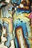 Microscope-art avec les cristaux de flambage Photographie stock libre de droits