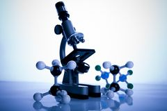 Microscope and atom Stock Images