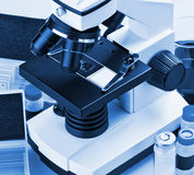 Microscope and biological reagents Royalty Free Stock Image