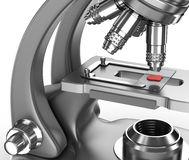 Microscope with a blood sample on a glass slide Royalty Free Stock Photography