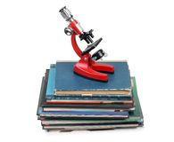Microscope on book royalty free stock photography