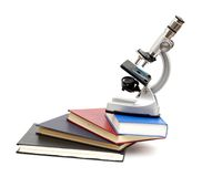 Microscope, books Stock Photography