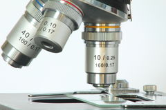 Microscope. Close up image of the slide and lenses of a microscope royalty free stock photos