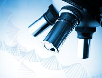 Microscope and DNA molecule. Microscope in the laboratory, and DNA molecule royalty free stock images