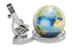 Microscope with Earth Globe, global research and discovery conce. Pt Stock Image