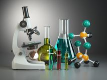 Microscope with flasks, vials and model of molecule. Chemistry o Royalty Free Stock Photos
