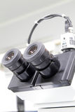 Microscope. High power microscope with multiple lens in lab Stock Photos