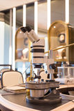 Microscope. A microscope in the jewelry shop,used to view diamond stock photos