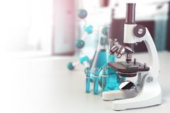 Microscope with lab glassware, flasks and colbas.Science laborat Royalty Free Stock Images