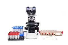 Microscope with laboratory equipment Royalty Free Stock Image