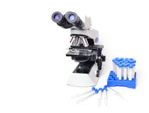Microscope with laboratory equipment Stock Photography