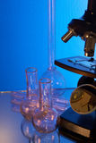 Microscope and laboratory glasswares Royalty Free Stock Image
