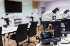 Microscope in laboratory room Stock Image