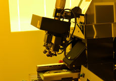 Microscope in laboratory under the yellow light for working with. Microscope in laboratory under the yellow light for working Royalty Free Stock Photography