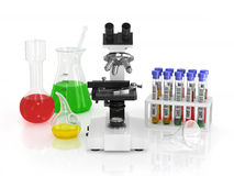 Microscope and medical utensils. Royalty Free Stock Photos