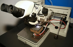 Microscope and PCB. The microscope is used to control chip stock photography
