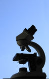 Microscope silhouette Stock Images