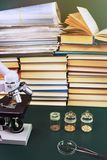 Microscope and test specimens on the table with books Stock Photo