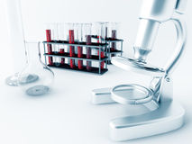 Microscope and test tubes Royalty Free Stock Images