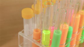 Microscope and test tubes in science lab. Microscope and bright test tubes in science lab, slider motion stock footage