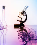 Microscope and test tubes used in laboratory Royalty Free Stock Photo