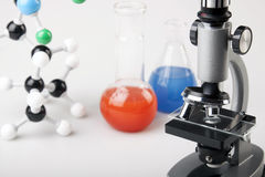 Microscope and Vials with Fluid Stock Photo