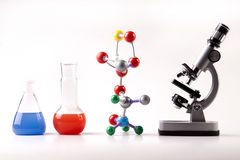 Microscope and Vials with Fluid and Atoms Stock Photos