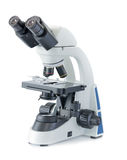Microscope on white background. Science and technology concept royalty free stock photo