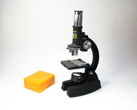The microscope on a white background. Stock Image