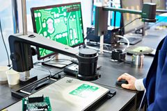 Microscopes for electronic boards with monitors. Microscopes for industrial electronic boards with monitors royalty free stock photo