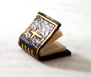 Microscopic book. A very tiny book measuring only half a centimetre, with the christian cross on the cover Stock Photography