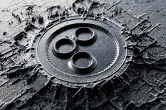 Cryptocurrency Casting Omisego. A microscopic closeup concept of cast or mined metal that builds up to form a physical omisego cryptocurrency symbol - 3D render Royalty Free Stock Image