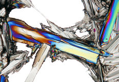 Microscopic view of potassium nitrate crystal in polarized light. Microscopic view of colorful potassium nitrate crystal. Polarized light, partially crossed Stock Photos