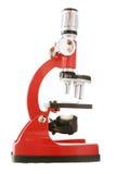 Microscopio isolato fotografie stock
