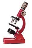 Microscopio rojo Fotos de archivo libres de regalías