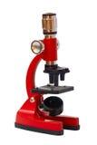 Microscopio rojo Foto de archivo libre de regalías